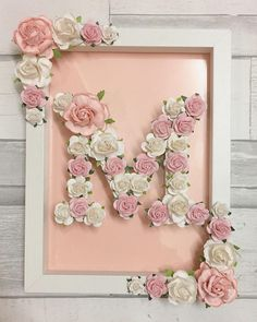 Wooden letter hand painted and decorated using high quality handmade paper flowers. Finished by framing In a matching floral frame. This is the ultimate girly gift and is perfect for all occasions