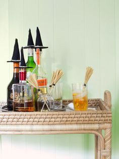 Top your liquor bottles with these DIY witch hats for easy Halloween Decor