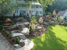 Now, this is what I want my front yard to look like. That is an incredible looking arrangement there. The stairs have to be my favorite part. I wonder if I could so something similar in the back yard, but with a patio up top.