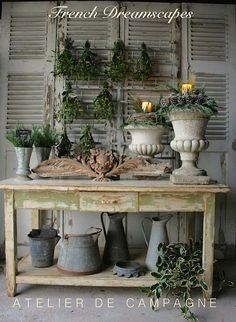 White iron urns used as candle holders