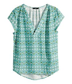 Airy turquoise V-neck blouse with short sleeves. | H&M Pastels