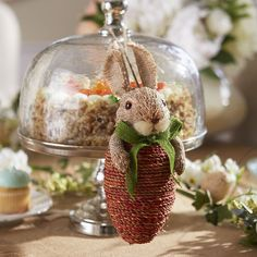 Our dapper bunny will be a welcome guest at your Easter celebration this year. Crafted by hand from natural grass over a foam core, he adds instant charm when hung from walls and fixtures.