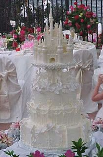 Amazing traditional white Disney castle wedding cake fit for a princess.