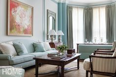 A beautiful living room in a Boston brownstone designed by Catherine & McClure interiors.