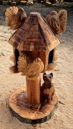 Fan tailed doves on dovecote with lurking cat, carved from Beech.