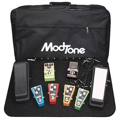 Modtone Powered Pedal Board 8 Out with power supply, 8 power cables and carry bag. PEDALS NOT INCLUDEDThe ModTone Powered Pedalboard is the go-to choice to get all of your favorite effects on one board for your next gig. Not only does the Powered Pedalboard have enough room to house all of your effects, it also has the power you need to keep them running all night. The included 9vDC power supply will dish out up to 450mA to keep all of your pedals performing to their max. The Powered…