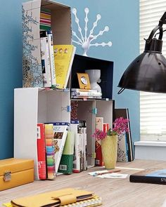 Pin together shoe boxes with clips to store light books and papers. If you prefer to be more decorative, cover the shoe boxes in shelf lining or wrapping paper.