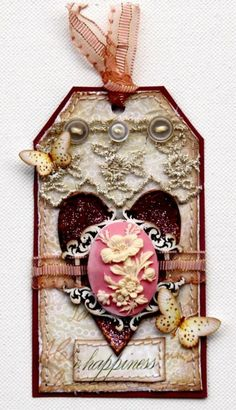 wow. mix it up. buttons, paper, jewelry, fabric, lace, ribbon...all stitched together. really nice!
