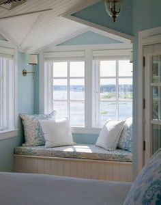 Are you longing for a beach getaway? This window seat is the perfect spot to spend a dreamy afternoon. I have always wanted a home with a window seat with a great view! Beach House Tour, Beach House Decor, Summer House Decor, Pale Blue Paints, Deco Marine, Cottages By The Sea, Beach Cottages, Beach Houses, Tiny Cottages