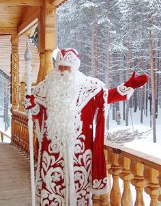 "The Russian Santa Claus, ""Ded Moroz"" or Father Frost, is more often seen in the traditional blue robes that match his granddaughter's, the Snow Maiden."