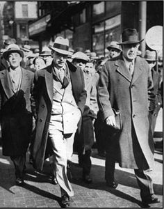 Owney Madden, left, suspected but unconvicted racketeering boss, is escorted by detective Thomas Horan shortly after Madden was ordered on February 13, 1932, to report to Sing Sing as a possible parole violator. He was en route to the Tombs Prison in New York pending a hearing two days later.