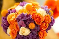 purple hydrangea with orange roses and billy balls