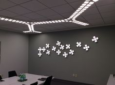 OLED Trilia (ceiling) & Revel (wall) from Acuity Brands