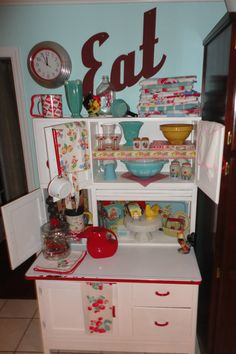 Vintage Hoosier Cabinet with some lovely pryex and old dishtowels.