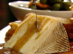 Manchego with Honey Brown Butter Sauce : Tyler Florence's simple appetizer comes together in seconds and will leave guests wondering why they didn't think of the ingenious honey-Manchego combo.