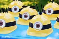 Minion Mayhem Birthday Party.... I used Electrical tape around the hat printed out some eyes from a diff project glued those on and didnt have any pipe cleaners so left those off and stapled on some elastic to keep the hats on ▶