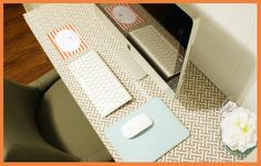inspiring desk ideas fabric or wallpaper covered by floating plexi-glass. iheart organizing
