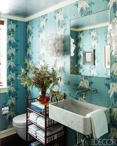 15 Tiny Bathrooms With Major Chic Factor via @MyDomaine.  Love the wallpaper, but this SINK!!!