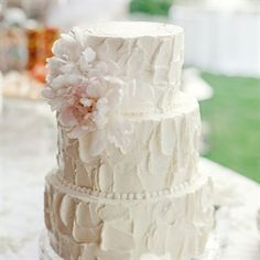 The three-tiered cake was one of three that the couple served to their guests.