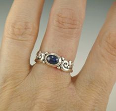 R985- Sterling Silver Ring with a 7 x 5 mm AAA Blue Sapphire Cabochon. Size 7 1/2. I can size it to fit, just contact me. No charge to size down, and no charge for one size up. The top of the ring measures 7 mm and the band is 2 mm. This ring is made by the Lost wax Casting