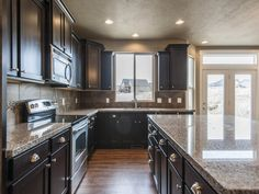 New Kitchen Dark Cabinets new caledonia granite countertops and white glass tile backsplash