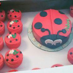 Lady bug cake w/cupcakes by @curshanacakes