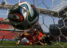 Memphis Depay of the Netherlands scores against Chile during their 2014 World Cup Group B soccer match at the Corinthians arena in Sao Paulo . IVAN ALVARADO/REUTERS