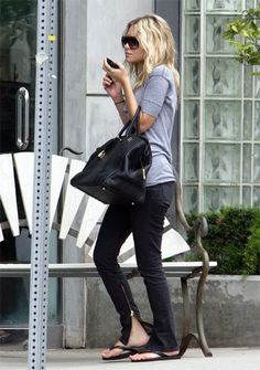 black jeans with grey & black accessories looks sporty & simple