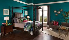 trend in bedroom paint teal wall color wood flooring poster bed