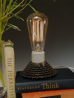 Desk Lamp made from repurposed bicycle part. A one-of-a-kind green gift for a biker, gear head or bookworm.. $79.00, via Etsy.