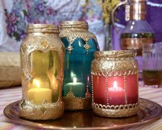 "DIY: ""Morrocan"" Lanterns; metallic puff paint, colored glass paint, salsa jar. may need to do some of these for the tent or pennsic camp too!!"