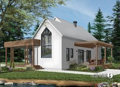 Modern one-story house plan with lots of natural light, cathedral ceiling, laundry on main floor, storage