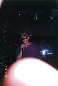 "This is a pic of Erik Kristensen at the Lamplighter doing Kariokee. From my memory of the event, he was doing ""Purple Rain"" in a Kermit the Frog voice.What can I say, the Lamplighter's was the place to be if you want to sing. It did not take that much to coach Erik to sing like Kermit the Frog."