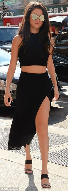 Fall vibes: The dark haired beauty wore a revealing two piece look that showed a lot of le...