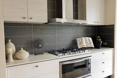 Large slate tiles on kitchen wall
