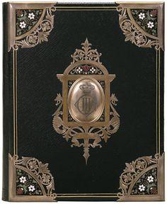 Black leather, enamel and etched brass. Binder: Eduard Becher, 1870-1880. Netherlands.
