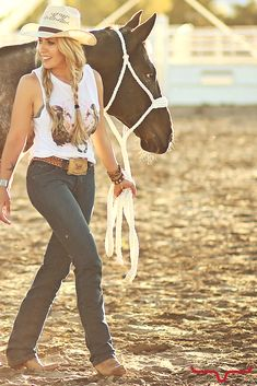 Love the rodeo flare on this outfit! The graphic tee, paired with our favorite new blue jean- Betty 17. This outfit is perfect for rodeo slack or a night time performance!