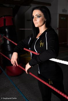 Model wears black S.H crop hoodie with black S.H embroidered exercise leggings.
