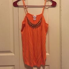 Tank top Orange with gold decals on front. Light and great for summer or for under a cardigan. Worn maybe twice. Candie's Tops