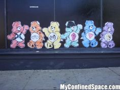 """Care Bears in San Francisco - I used to see different ones throughout the city.  """"A whole rainbow of bears: Leather bear, handcuff bondage bear (with """"Daddy"""" tattoo), piggy bear, pink gay power fist bear (with black bandanna – maybe he's bash back bear?), pink triangle bear, Lady Bunny drag queen bear (looks like ze has tribal tattoos also.) Great details, anonymous artist! On Folsom Street near 8th in San Francisco."""""""