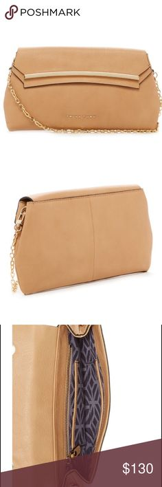 """Trina Turk Lyon Flap in Camel A clever clutch, the Lyon Flap can go from day to night. It's the perfect size to carry everything important and in classic camel nappa leather, it goes with everything. With a flap opening and sleek style, the detachable shoulder strap allows for hands free ease, too. Dimensions: L: 11.5"""" W: 1.5"""" H: 6.5"""" Detachable chian shoulder strap: 17"""". Includes trina dust bag. Brand new with tags Trina Turk Bags Clutches & Wristlets"""