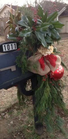 Christmas 2013 - Natural Burlap, Red Burlap, Off-white Hydrangea, Red Berries, an Over-sized Ornament, and Fresh Evergreens create a beautiful Christmas mailbox - side one.