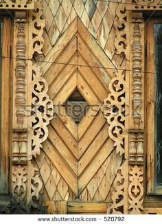 Window decoration. Wooden architecture, detail. Carpathian Mountains, Ukraine. by Svetlana Tikhonova, via ShutterStock
