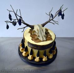 Surprise birthday cake made by Conjurer's Kitchen for one of the lovely actors from Vikings. Based on the skull wedding cake, but with a viking theme, and a skull with branches for antlers, decorated with crow feathers. All edible except antlers/branches.