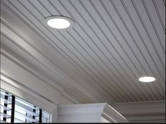 Recessed lighting in a beaded ceiling using adjustable low voltage fixtures.
