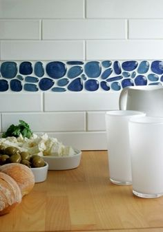 Recycled glass in subway tile bathroom - nice beachy tone, would be even better with seaglass effect pebbles.