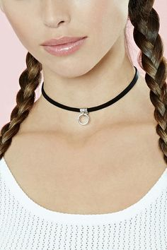 A faux leather choker with a dangling hoop charm, a lobster clasp, and a high-polish finish. #accessorize