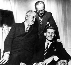 """John Francis """"Honey Fitz"""" Fitzgerald (left), with his son-in-law Joe Kennedy Sr. (standing), and his grandson, John Fitzgerald Kennedy (seated). Honey Fitz was once the mayor of Boston and a US Congressman."""
