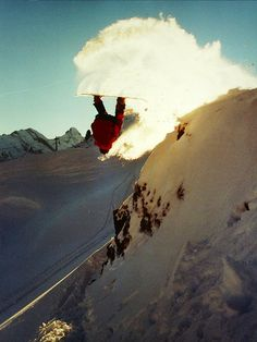 A nice frontflip off a cliff with a huge snow spray lit by the sun | Backcountry of Shilthorn, Switzerland