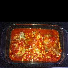 One of my favorite Italian dishes perfected by my grandma. Start by making your favorite tomato sauce (i prefer sauce from crushed tomatoes or whole plum tomatoes). Brown pork chops. Add drained cannelli beans to sauce and let warm while oven preheats to 350. Pour sauce into baking dish. Lay pork chops on top. Cover and bake 45 minutes. Serve over white rice. Delicious. Pork Chop Dishes, Plum Tomatoes, White Rice, Italian Dishes, Pork Chops, Tomato Sauce, Food For Thought, Casseroles, Entrees